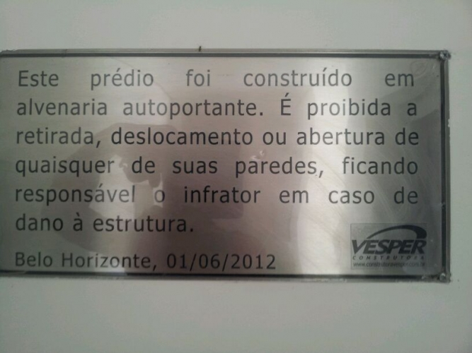 Placa de advertencia em a�o inox